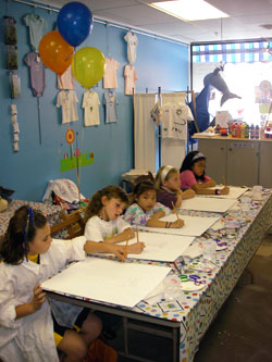 Birthday party table with children painting