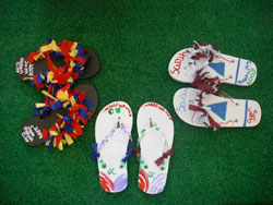 Three pairs of arts & crafts sandals made by children